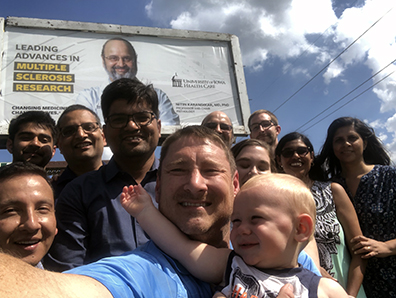 Karandikar with his lab members in front of the billboard